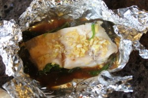 Steamed Ginger Fish on Wilted Spinach