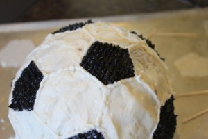 Icing the Soccer Ball Cake